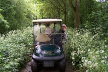 Golfer en Caddy